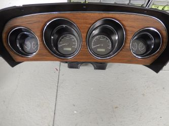 We can install modern instruments in a vintage dashboard. This can give a built in tach and all the gages.